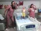 DANCING CANCER PATIENT!!  Nurses dancing with a little girl!