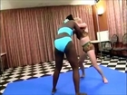 Figure 4 headlock and headscissors (strong black female wrestling). 黒人女性レスリング